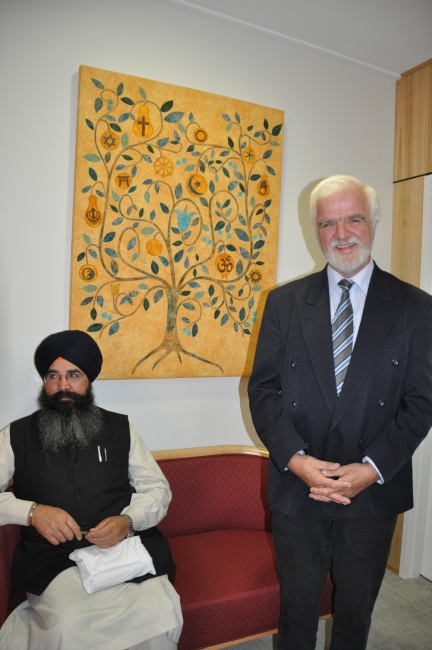 Former Hospital board chairman Clem Furphy with Sikh community member, next to tree artwork