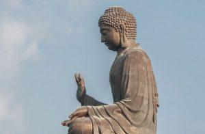 Buddha with hand raised in mudra