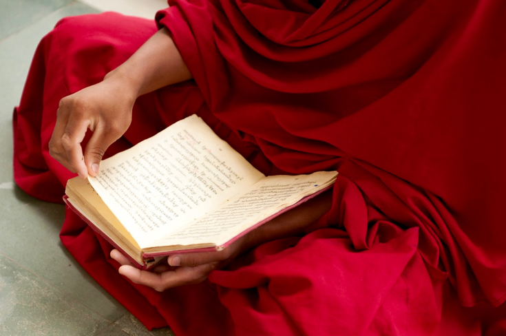 Buddhist monk with Buddhist scriptures