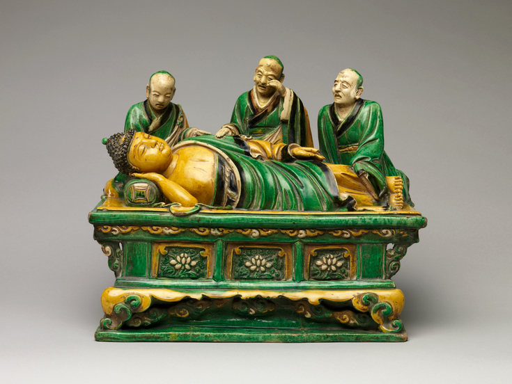 Stoneware sculpture of the Buddha as he lay dying