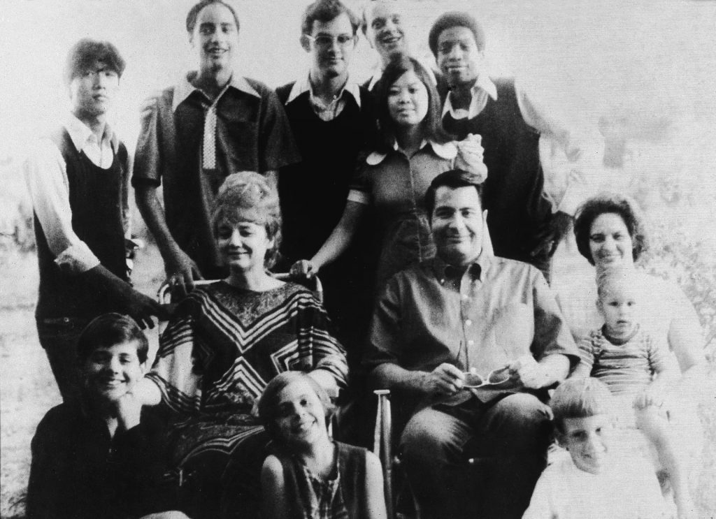 Jim Jones and his wife, Marceline Jones with family members in 1976, a year before their move to Guyana.