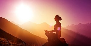 woman meditating in sunlight