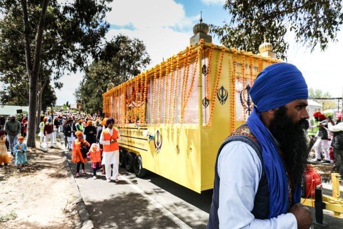 A mobile gurdwara weaves its way through Bendigo followed by a procession.