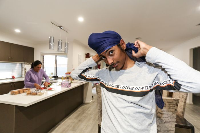 Kanwardeep tying his patka often worn by children before donning the turban.