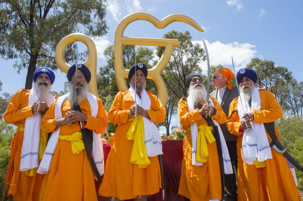 Sikhs with the Ik Onkar at the Peace Park in Bendigo