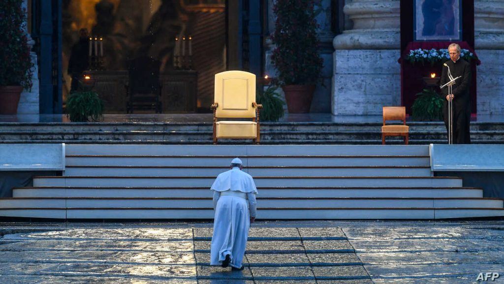 Pope Francis walks toward the platform to preside over a moment of prayer on the sagrato of St Peter's Basilica, at the Vatican.