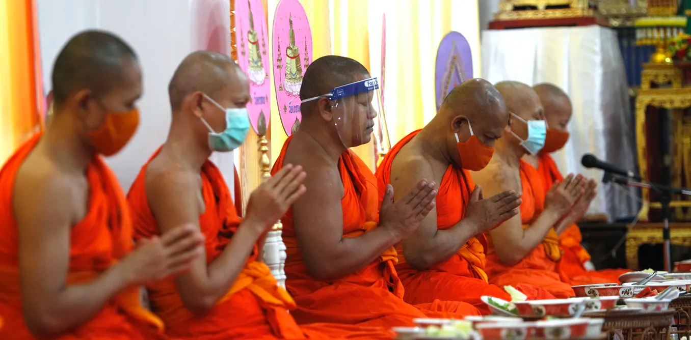Buddhist monks in Thailand pray at Phleng temple amid the COVID-19 crisis, May 11, 2020.
