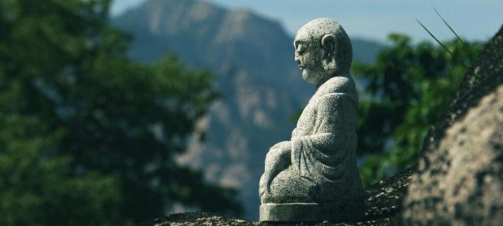 buddha statue mountain view