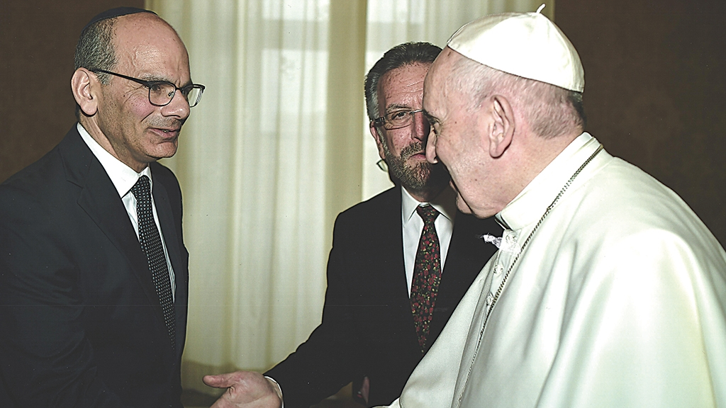 Rabbi Noam Marans shakes hands with Pope Francis